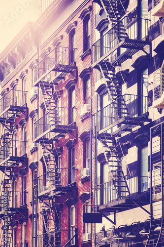 Poster New York City Vintage toned picture of a building with fire escape ladders, New York City, USA.