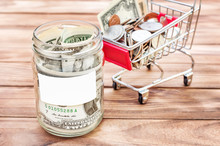 Dollar Bills In Glass Jar With...