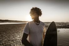 Surfer Portrait Against At Sunset