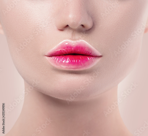 Gradient lipstick trendy lips makeup closeup. Pink and white lips colors, nude make-up sample. Beautiful lips, sexy mouth