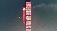 Top View Of A Large Loaded Container Ship And A Tanker Standing Side By Side.
