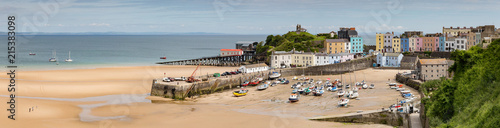 Fototapeta Panoramic view of the harbour and beach at Tenby on the Pembrokeshire coast, Wal