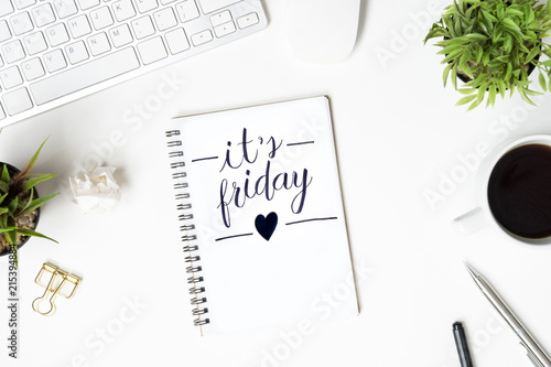 Papel de parede Notebook with it's friday calligraphy text is on top of white office desk table