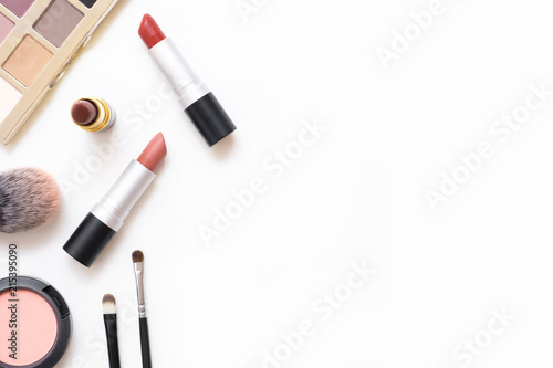 Fotomural Top view of female table with makeup including lipsticks, eye palette, foundation, brushes and others