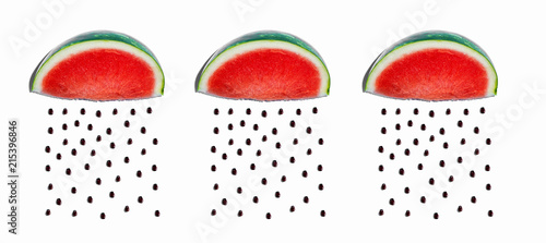 Watermelons and seeds rain concept on a white bakcground