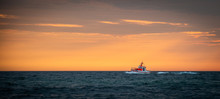 Emergency Rescue Boat Infront Of Sunset