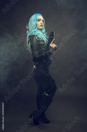 Fotografie, Obraz  Cosplay futuristic action female with blue hair