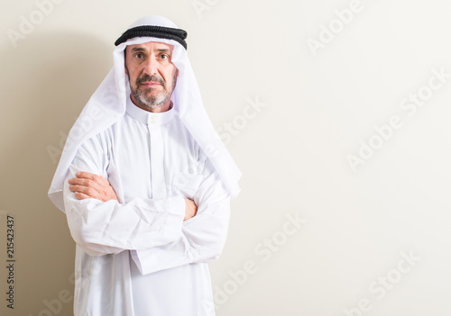 Senior arabic man with a confident expression on smart face thinking serious