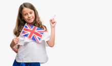 Brunette Hispanic Girl Holding Flag Of United Kingdom Very Happy Pointing With Hand And Finger To The Side