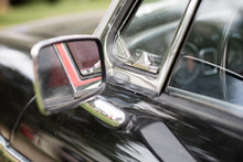 Chrome Mirror In An Old Car. Accessories In Cars Exhibited At Shows.