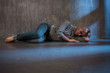 Depression. Young woman lying on the floor
