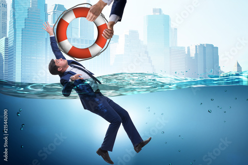 Businessman being saved from drowning Fototapeta