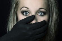Frightened Blonde Woman Grabbe...
