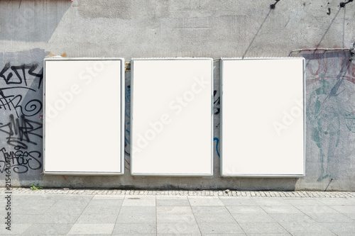 Obraz Thee empty advertising billboards on the wall of building - fototapety do salonu