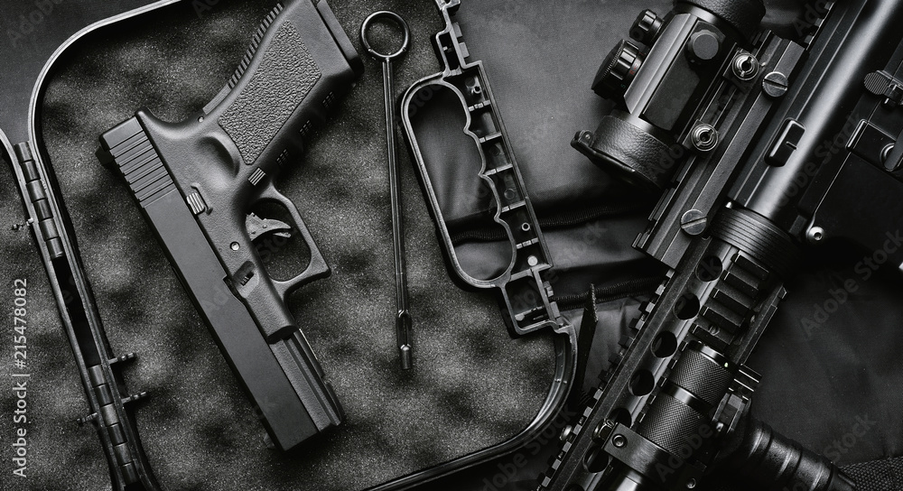 Fototapeta Weapons and military equipment for army, Assault rifle gun (M4A1) and handgun on black background.