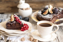 Chocolate Cake With Berries And Coffee, Decor Of Red Currants And Figs. Autumn Fruits And Pastries For Breakfast