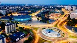 Aerial drone view on Katowice centre and roundabout at night.