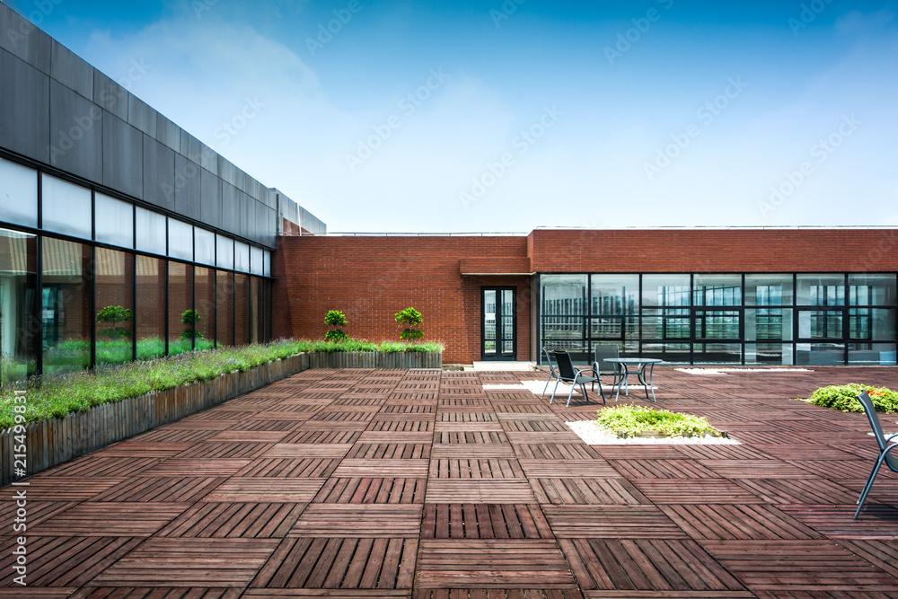 Fototapeta Stylized altered generic corporate modern office building