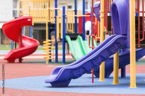Fotografía  Children's colored slides playground on a street.