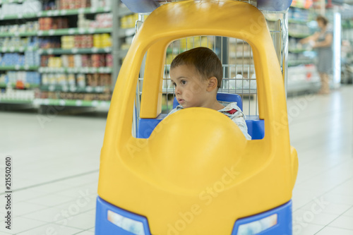 a6d73b8b34bb Cute sad little 2 year old baby boy child in the little toy-car ...