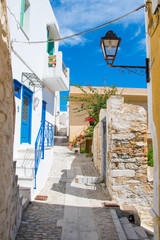 Fototapeta Paved narrow alley of Ano Syros in Syros island, Cyclades, Greece. Street view