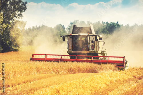 Leinwand Poster combine harvester working on the cereal field
