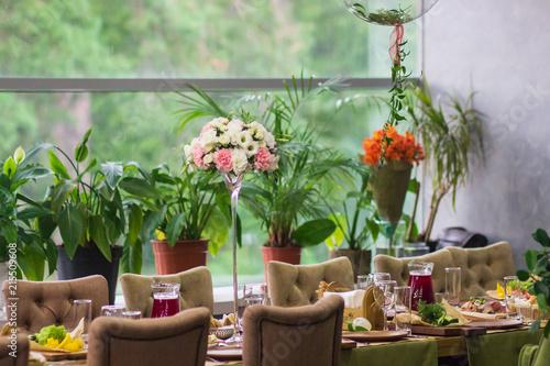 Fotobehang Tuin Beautiful flowers in vase on table in room