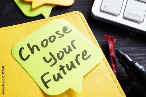 Photo  Choose your future written on a memo stick and pen.