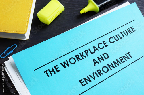 Fotografiet  The workplace culture and environment report on a desk.