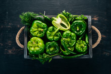 Fresh Green Pepper In A Wooden Box. Organic Food. Top View. Free Space For Text.