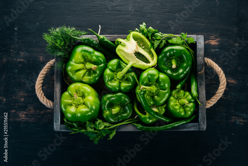 Fresh green pepper in a wooden box Wallpaper Mural