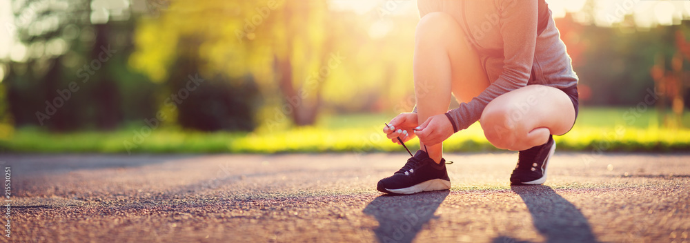 Fototapety, obrazy: Young woman running in the park. Active person outdoors at the dusk in summer