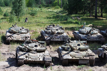 Military Polygon. Combat Vehicles. Military Tanks In The Background Of The Forest.