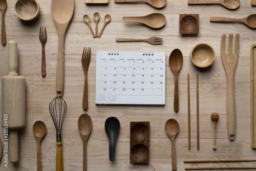 kitchen utensils and calendar, time for prepare or study for cooking