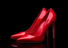 Red High Heeled Shoes And Black Background