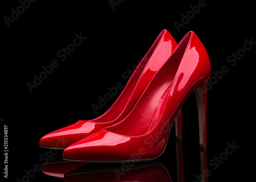 Obraz na plátně Red high heeled shoes and black background