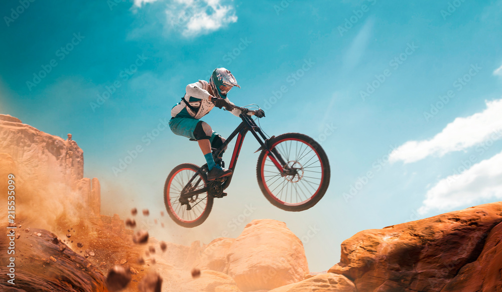 Fototapeta Cyclist riding a bicycle. Downhill.