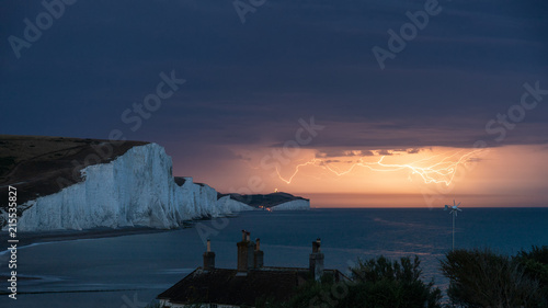Foto op Plexiglas Nachtblauw Stunning moody electrical lightning storm over white cliffs landscape, on English South Coast
