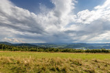 Rural scenery. Fields, mountains with amazing clouds on the sky. Pieniny National Park. Malopolska, Poland.