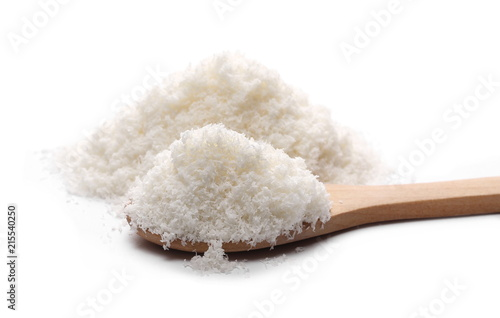 Pile of shredded coconut meat with wooden spoon isolated on white background