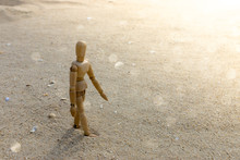 Wooden Models Feel Lonely On The Beach.