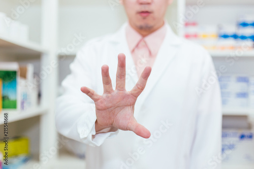 Doctor doing pinching pose on invisible virtual screen - with copy