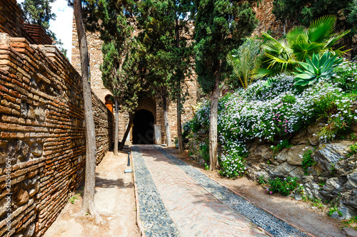 courtyard of alcazaba castle in Malaga, Costa del Sol, Spain Fotobehang