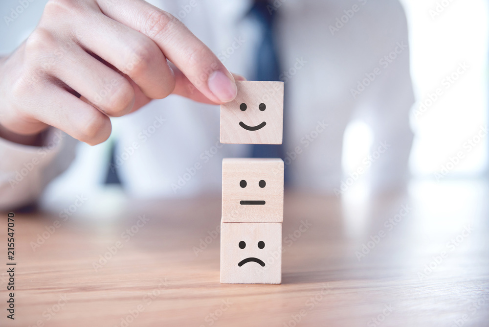 Fototapeta Businessman showing rating with happy icon, Customer satisfaction survey concept