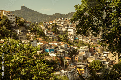 Favela in Rio de Janeiro with Christ the Redeemer statue in the background
