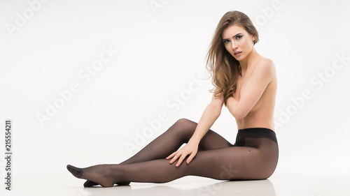 Fototapety, obrazy: naked girl in pantyhose. isolated. on a white background.