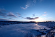 Sunset on icelandeic tundra with snow and ice