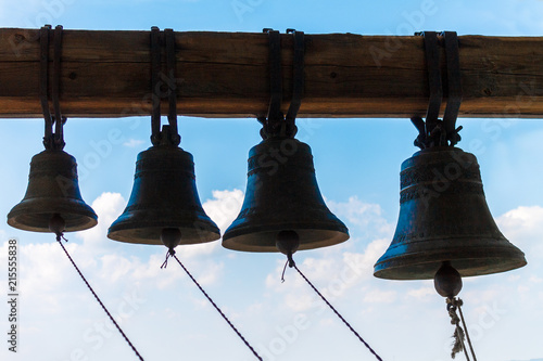 Fotografie, Tablou  Bronze bells ringing on the tower of the temple.