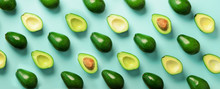Avocado Pattern On Blue Background. Top View. Banner. Pop Art Design, Creative Summer Food Concept. Green Avocadoes, Minimal Flat Lay Style. Banner