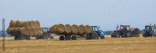 harvesting in the field,Hay bales,tractor Canvas Print